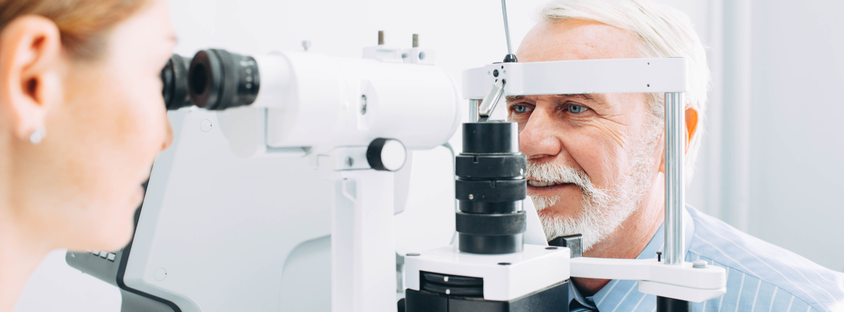 Older male having eye examined
